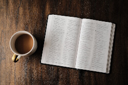 Open Bible and a cup of coffee