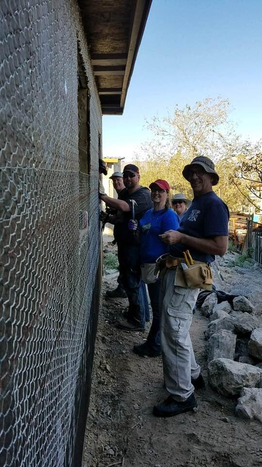 Members of Casas Por Cristos building a house